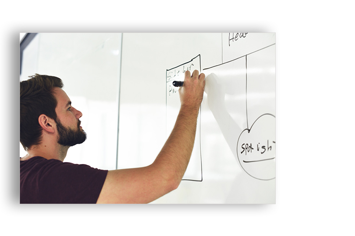 screenshot of a guy drawing on a board